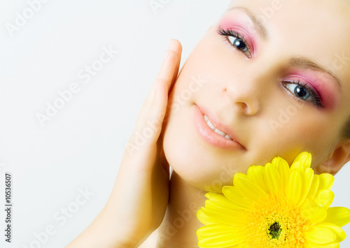 Young woman with gerbera flower.