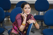 Indian Businesswoman Using Cell Phone