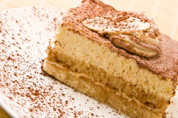 Delicious tiramisu with chocolate on a plate