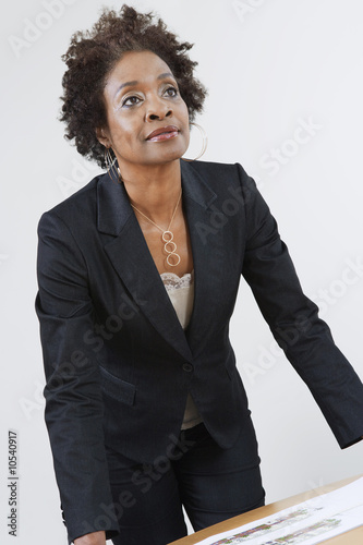 Businesswoman Leaning on Table
