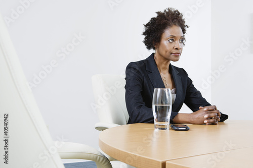 Businesswoman with Hands Clasped