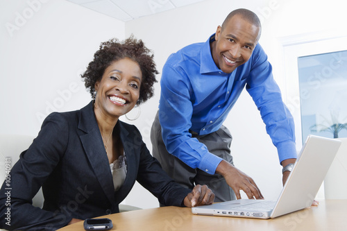 Businesspeople Using Laptop