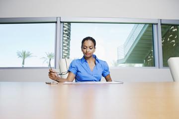 Businesswoman Reading Booklet
