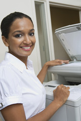 Businesswoman Using Photocopier