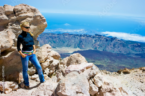 Girl standing on the edge of the volcano