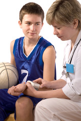 doctor checks a blood pressure at the young sportsman