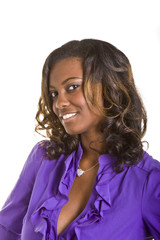 A beautiful black woman in a purple blouse on white