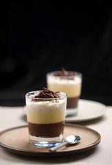 Delicious chocolate trifle dessert on dark background