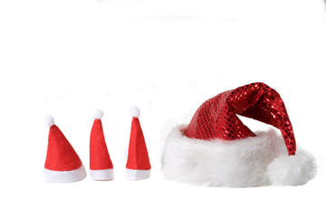 Christmas hats in various sizes on white background