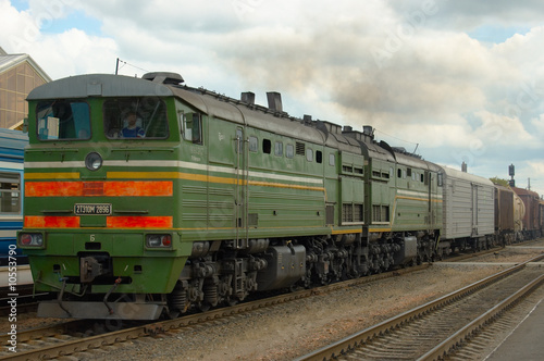 The cargo disel locomotive drives a heavy train