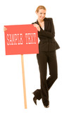 Young businesswoman standing with red signboard poster