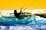 kite boarder action with sunset..