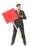 Businessman standing with red signboard, isolated poster
