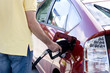male topping up car tank with unleaded 95 gasoline