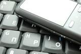 gadget  over laptop keyboard poster