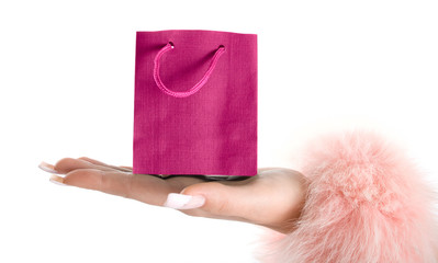 Pink paper-bag on hand.