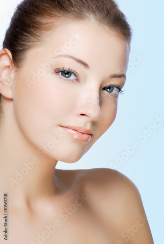 Attractive natural woman face isolated on white.