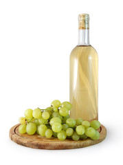 bottle of white wine and a bunch of grapes on white background