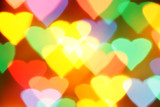 Colorful hearts bokeh, may be used as background poster
