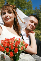 Young couple and wedding bouquet