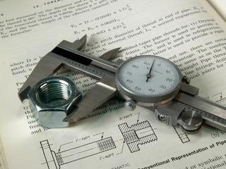 Dialcaliper on technical book