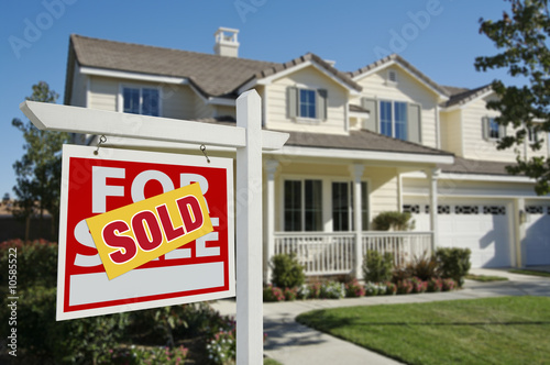 Leinwandbild Motiv Sold Home For Sale Sign and House