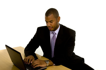 Black Man Typing on Laptop