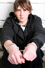 teenager in handcuffs - criminal portrait