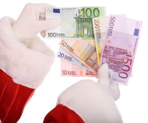 Group of money in hand of santa claus.