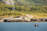 boat opposite hilly Norwegian coast with polar circle sign poster