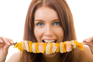 Portrait of young happy woman eating shish kebab, isolated