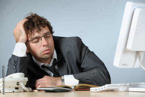 Sleeping young businessman