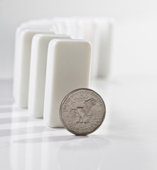One dollar coin and domino tiles