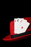 Three aces on felt hat, isolated on black background; concept fo poster
