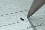 Closeup of pen writing on a blank bank check poster