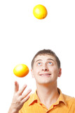 young adult man juggle with oranges poster