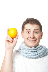 young adult man holding orange