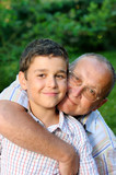Smiling grandfather and grandson poster