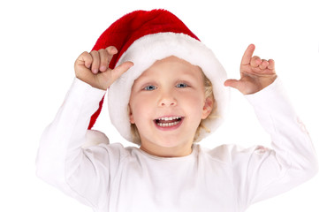 Mädchen mit Weihnachtsmütze lachend