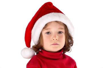 Kind traurig mit Weihnachtsmütze