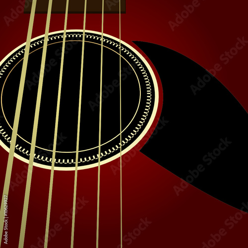 Dark acoustic guitar close up