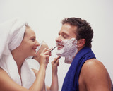 a young woman shaves her husband poster