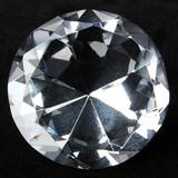 Round brilliant diamond over black velvet poster