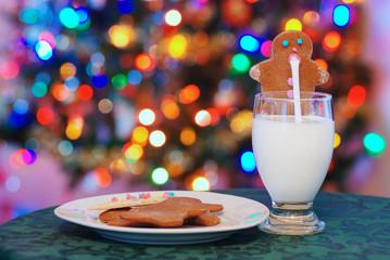 gingerbread man drinking santa claus milk