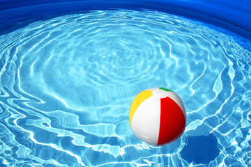 Beach ball floating on pool