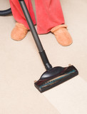 Housewife vacuum a carpet poster