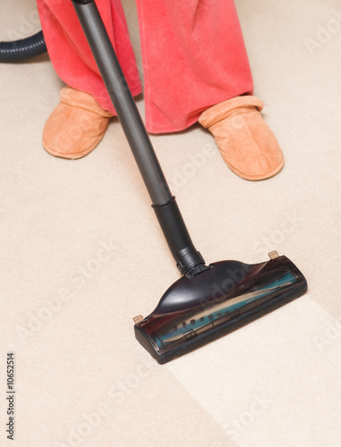 poster of Housewife vacuum a carpet