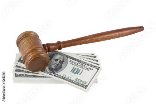 Wood gavel over some bank notes isolated