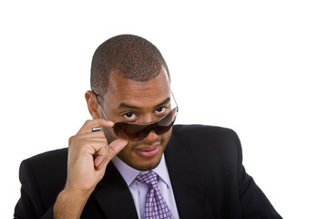 Black Man in Suit Looking Over Sunglasses