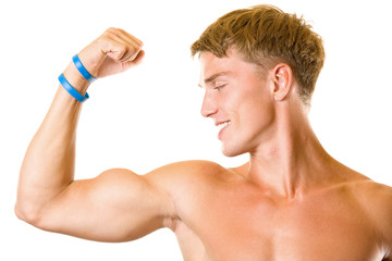Portrait of handsome muscular man flexing biceps, isolated